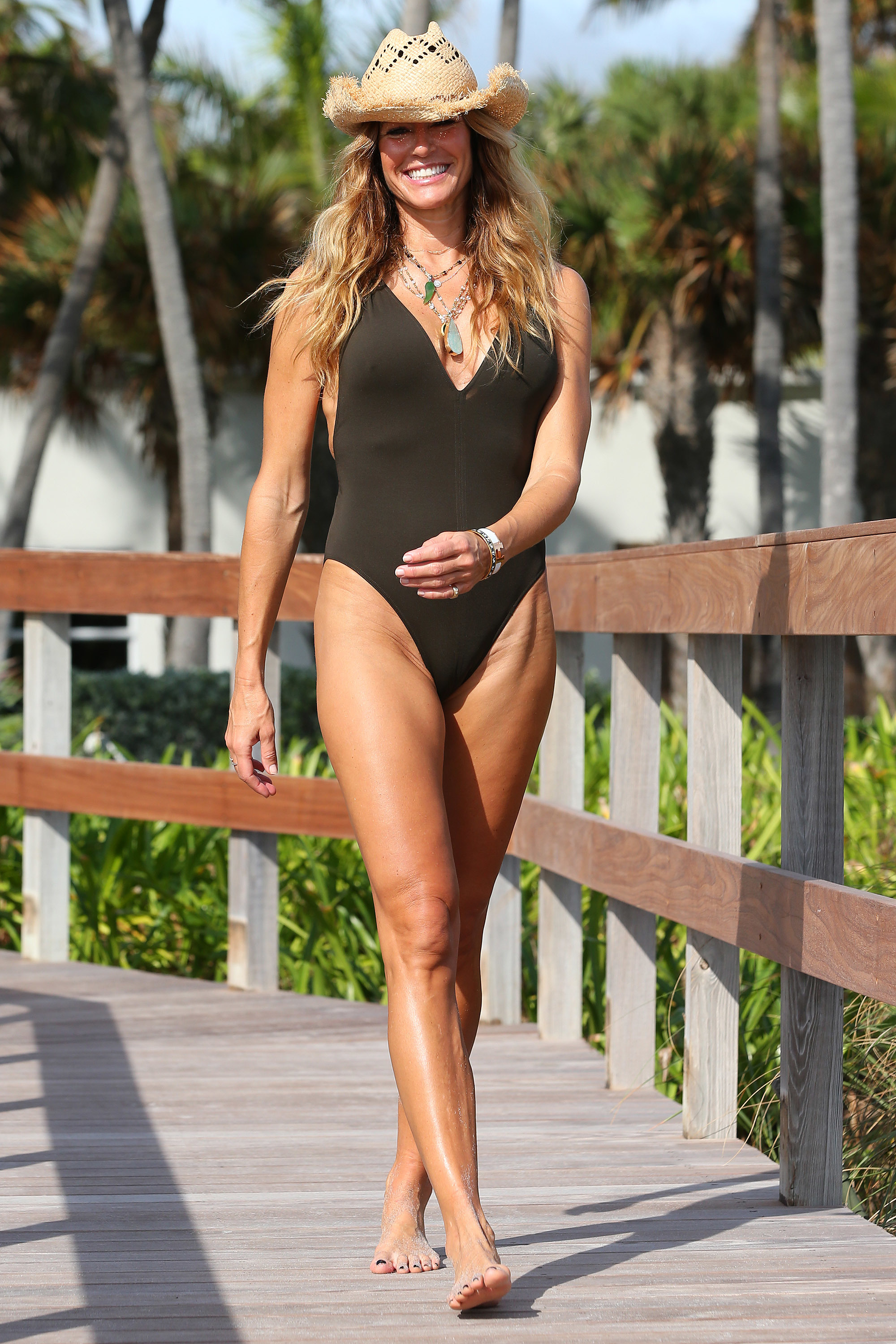 Kelly Bensimon Swimsuit and Cowboy Hat