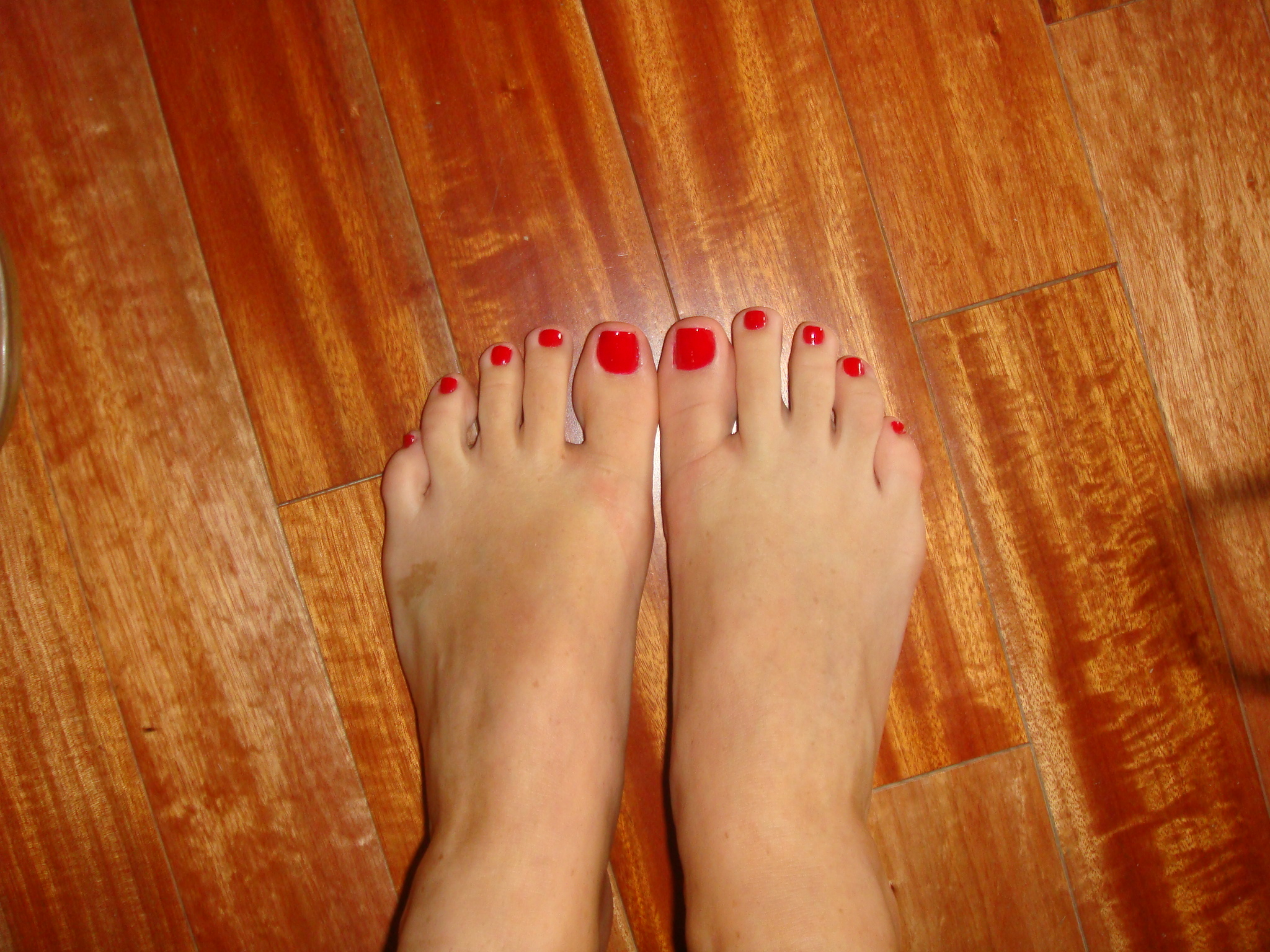 image Long red toenails sole view