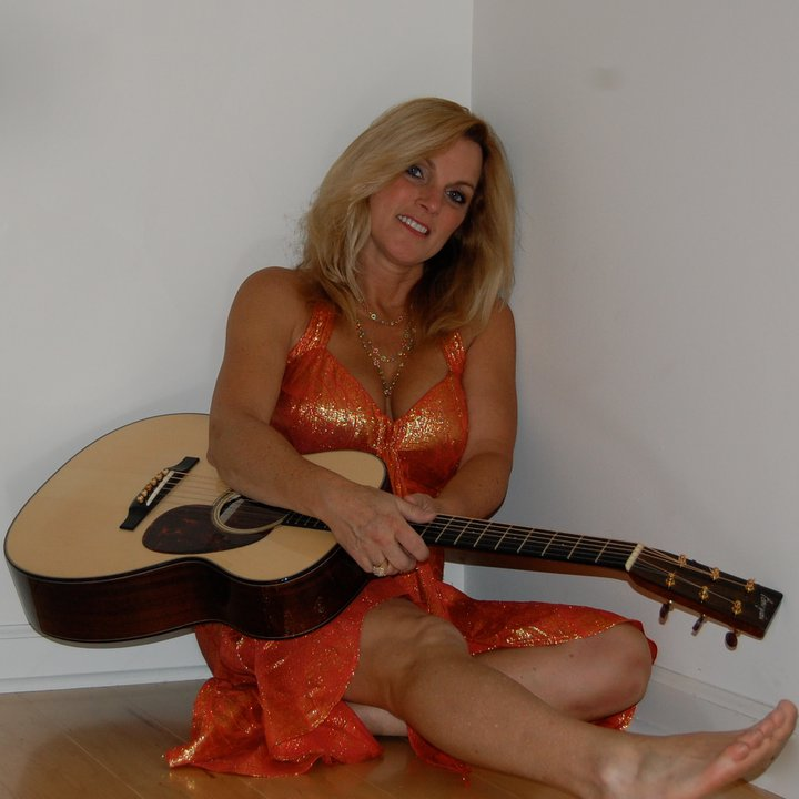 Nude woman with guitar