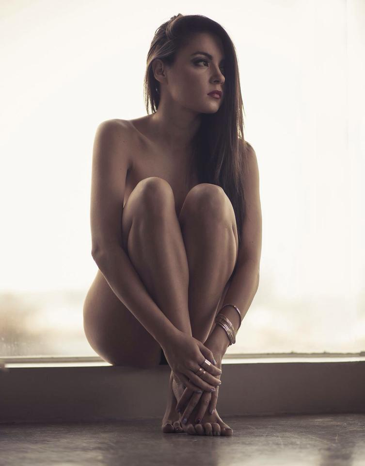 a naked girl showering